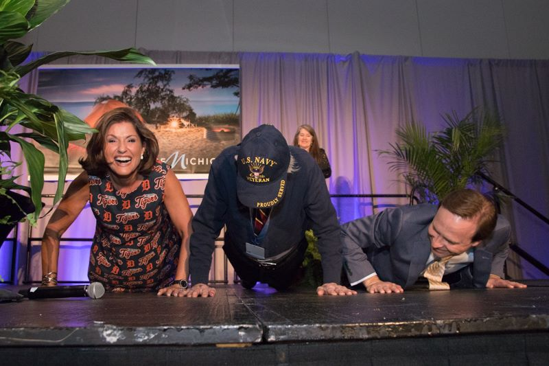 Active Senior Award winner, Fred Winter, do push ups on stage at the GFA Gala.